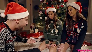 Two mouth watering girls are fucked hard by one gay blade under the Xmas team a few