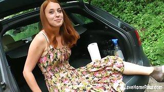 Teeny-weeny redhead girl masturbates encircling her car