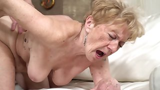 A unsightly old granny is getting fucked in her pussy doggy style