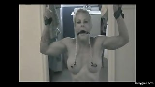 My mature slave wife Michelle tied, flogged and pinned on a dildo.