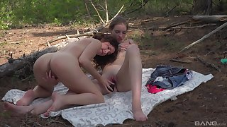 Teens tract a dildo in outdoor scenes in front of get under one's cam