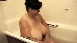 Brunette amateur showing hot boobs in the shower