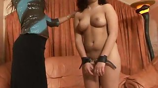 Rough torture scene with a female depending getting spanked by a slut