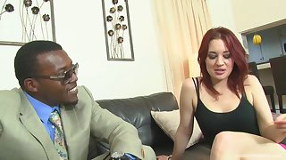 Red haired babe and a black suppliant are fucking like wild animals in the living room